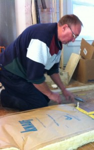 Steve measures insulation for the attic.